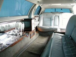 The interior of a stretch limo, complete with bar and entertainment center.