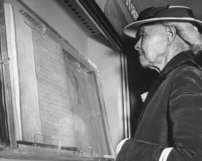 An ex-slave reads the Emancipation Proclamation in 1947.
