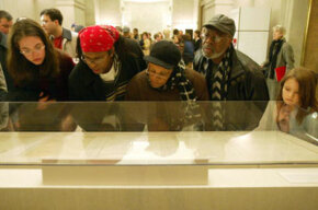 Visitors view the original Emancipation Proclamation during a one-day-only exhibit on Jan. 19, 2003, at the National Archives in Washington, D.C.