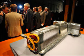 General Motors Chairman and CEO Ed Whitacre addresses the media next to the first lithium-ion battery off the assembly line for the Chevrolet Volt at the Brownstown Battery Pack Assembly in Brownstown Township, Mich., on Jan. 7, 2010.