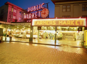 Many followers of the local food movement frequent farmers' markets like the Pike Street Market in Seattle.