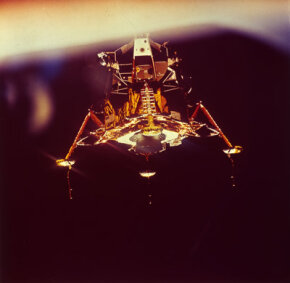 The Lunar Landing Module Eagle descends onto the surface of the moon, carrying Apollo 11 astronauts.