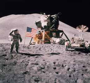 Astronaut James Irwin salutes in front of the landing module of Apollo 15 in August 1971.
