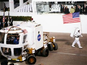 U.S. President Barack Obama and First Lady Michelle Obama watch NASA's lunar electric rover bring up the rear of the inaugural parade.