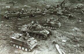 M-48A2s and armored personnel carriers of the 11th Armored Cavalry Regiment prepare for a sweep through Cambodia in 1970.