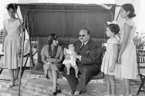 Egypt's deposed King Farouk posed with his family on the Isle of Capri where he was in exile, in 1953.
