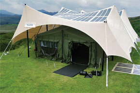 A 2kW PowerShade made by PowerFilm. Note the shelter's amorphous-silicon photovoltaic panels integrated directly in the shelter's fabric. One structure could produce about 10 kW per day.