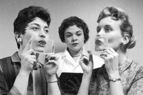 Women testing lipsticks for durability