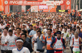 Runners compete in the Taipei International Marathon, Dec. 17, 2006. One great reason to marathon? To travel the world! See more Olympic pictures.