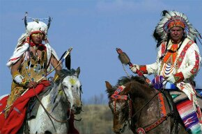 Canadian First Nation Cree Indians from Saskachewan are shown in traditional clothing.