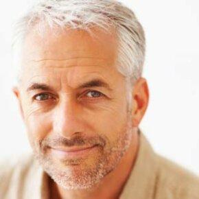 Mature gentleman smiling.