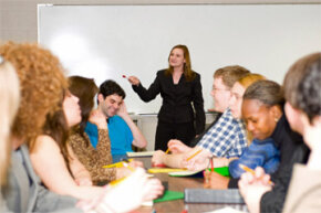 Business schools often rely on a mix of lectures from accomplished professors and collaborative group work.