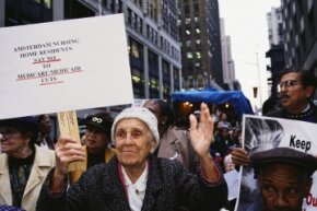 Medicaid's funding has long been a hot-button political issue. In this 1995 photo, an elderly woman protests cuts to Medicare and Medicaid at a health care march and rally in New York City.