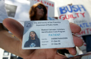 Lucas Thayer holds his medical marijuana club card during a demonstration in front of the San Francisco Hall of Justice on July 12, 2005.