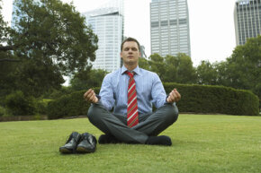 Meditation can result in real physiological changes. This man takes time out of his day to meditate in Sydney, Australia.