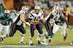 New England Patriots quarterback Tom Brady (12) during a game against the Miami Dolphins on Oct. 4, 2010, in Miami.