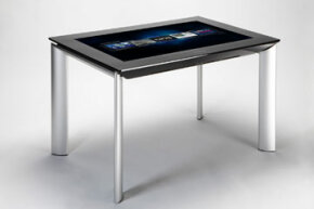 The Samsung SUR40 with Surface 2.0 shown here is only 4 inches (10.2 centimeters) deep. Its 1.0 ancestor, which housed cameras and projectors under the tabletop, sat on a full box unit full of component parts.
