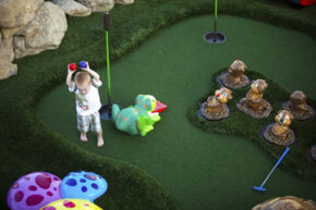 This Royal Caribbean ocean liner has an adorable miniature golf course on deck. You could have one in your own backyard too. See sports pictures.