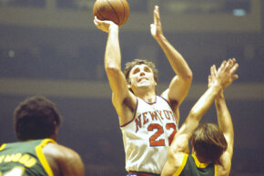 The Seattle SuperSonics are depicted in action around the time John Brisker played for them.