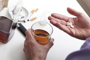 Pills and whiskey together?  Just say no.