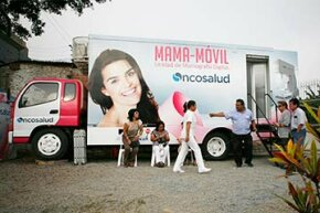 Women wait to receive a free mammogram outside of Peru's first mobile unit for breast cancer detection, in Lima.