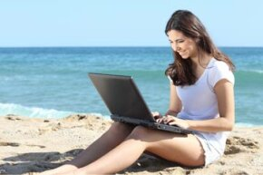 The freelancer's dream -- working on a laptop at the beach. Of course, reality is not always that lucky! See more money pictures.