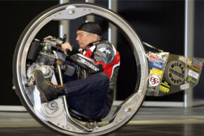 Image Gallery: Motorcycles Kerry McLean on his monowheel motorbike at the Essen Motor Show fair in Essen, Germany. See pictures of motorcycles.