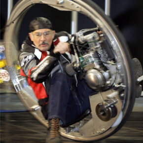 Kerry McLean drives his monowheel during a press preview for the Essen Motor Show fair in Essen, Germany.