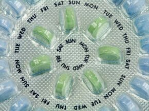 A birth control pill pack with 21 active pills and seven placebos