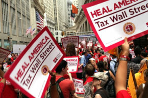 Members of the nurses' union, National Nurses United, march on Wall Street in June 2011 to protest income inequality. See more pictures of protests.
