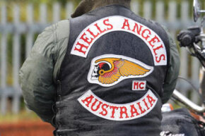 The Hells Angels' famous emblem is a skull with wings, wearing a motorcycle helmet.