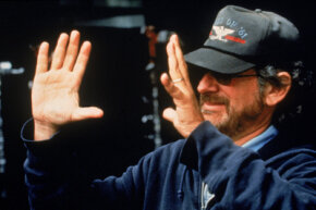 American director Steven Spielberg frames a shot on the set while directing his film 'Jurassic Park: The Lost World,' 1997. See more movie making pictures.