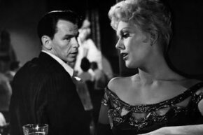 """Frank Sinatra and Kim Novak get up to something shady in the 1955 film """"The Man with the Golden Arm.""""  Despite not being approved by the Hays Code, this film was a hit and helped usher in the current MPAA ratings system. Want to learn more? Check out these Movie Making Pictures."""