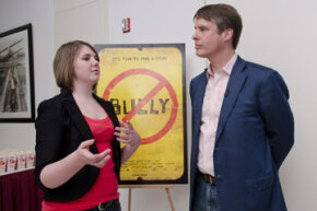 """Katy Butler, the 17-year-old high school student whose campaign to get the MPAA to change the ratings of the movie """"Bully"""" from an R to PG-13, poses with newscaster Terry Moran at a screening and discussion of the movie hosted by the MPAA."""