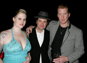 Musician Brody Dalle of The Distillers, music agent Robbie Fraser and musician Josh Homme of Queens of the Stone Age attend a party.