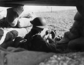 A soldier in a sandbagged trench circa 1940