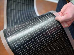 An engineer holds a sheet of thin-film solar cells at the National Renewable Energy Laboratory in Golden, Colo. Thanks to relatively low pricing and adaptability, thin film solar panels have quickly come to dominate the U.S. market in the last two years.