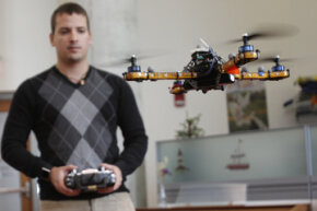 MIT graduate student Daniel Soltero demonstrates the use of a quadrotor inside the MIT Computer Science and Artificial Intelligence Laboratory. The nano quadrotor is a much smaller version of this.See robot pictures.