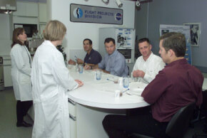 STS-113 crewmembers are briefed by dietitians during a food tasting.