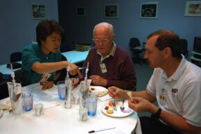Payload specialists Chiaki Mukai and Sen. John Glenn and mission commander Curtis L. Brown Jr. sample space foods.