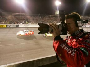 Carl Edwards, driver of the #99 Office Depot Ford, shoots a camera during the NASCAR Nextel Cup Series Chevy Rock & Roll 400 at Richmond International Raceway on Sept. 8, 2007 in Richmond, Va.