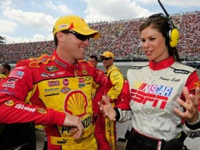Kevin Harvick, driver of the #29 Pennzoil Chevrolet, speaks with ESPN television personality Jamie Little prior to the start of the NASCAR Sprint Cup Series 3M Performance 400 at Michigan International Speedway on Aug. 17, 2008 in Brooklyn, Mich.