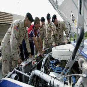 Roush Racing crew chief Doug Richert explains engine design and performance to members of the North Carolina National Guard.