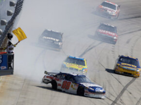 Dale Earnhardt Jr. spins after a blown tire, causing a yellow flag during a NASCAR Sprint Cup Series race at Dover International Speedway in Dover, Del.­ See more NASCAR pictures.