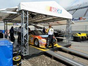 The car of driver Michael McDowell goes through inspection by NASCAR officials before the NASCAR Sprint Cup Best Buy 400 auto race, June 1, 2008, at Dover International Speedway in Dover, Del. See more pictures of NASCAR.