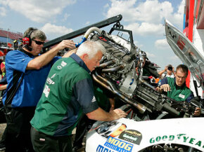 Dale Earnhardt Jr.'s pit crew install a new engine in his car during practice for the Amp Energy 500 on Oct. 3, 2008. NASCAR engines cost between $45,000 and $80,000.