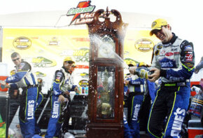 Jimmie Johnson sprays champagne on his crew after his victory in the NASCAR Nextel Cup Series Subway 500 in October 2006 in Martinsville, Va.