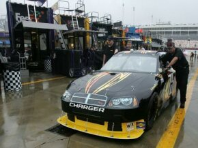 After rain canceled practice and qualifying for the NASCAR Sprint Cup Series Bank of America 400 in North Carolina, there was little left to do but to push the cars out of the garage area.