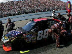 The pit stop crew performs various tune-ups, not the least of which is wedge adjustment. In the above picture, the crew member reaching over the rear windshield is adjusting the wedge.
