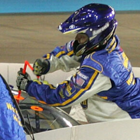 This pit crew member is adjusting the wedge mid-race to give the driver improvedhandling.